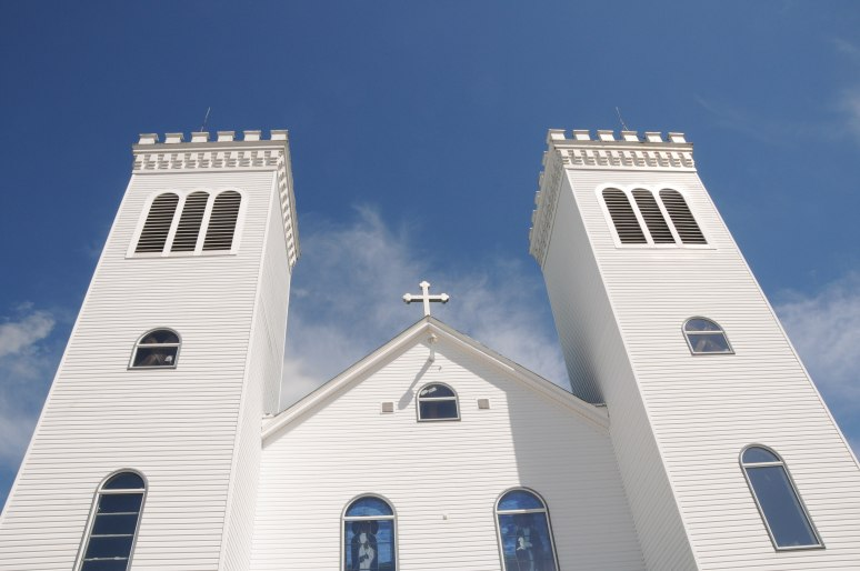 A bright day offers a nice contrast between the white church against a blue sky.