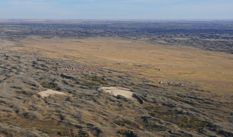 A homestead on the south edge of the dunes depicts the size of a hill.